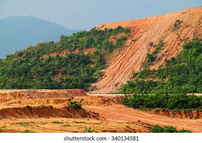 Earth erosion caused by hill deforestation for development work.