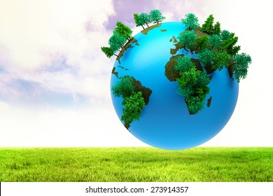 Earth with forest against blue sky over green field
