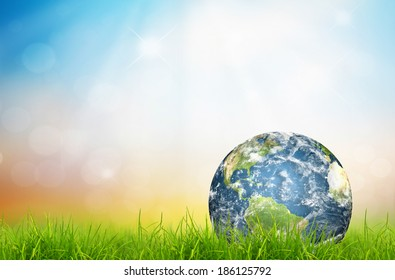 Earth in Fresh spring green grass (Elements of this image furnished by NASA)