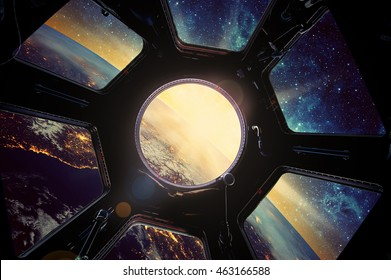 Earth and galaxy in spaceship window porthole. Elements of this image furnished by NASA.