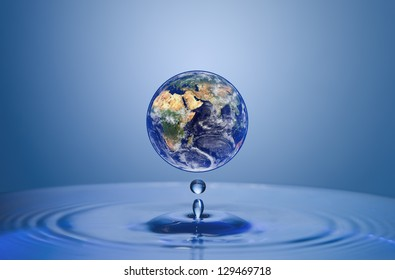 Earth globe above water surface close-up (elements of this image furnished by NASA)