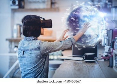 Earth globe against young woman using the virtual reality headset
