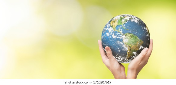 Earth globe in family hands. World environment day concept. Elements of this image furnished by NASA - Shutterstock ID 1710207619