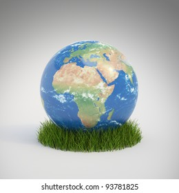 Earth globe growing in a patch of grass - ecology concept