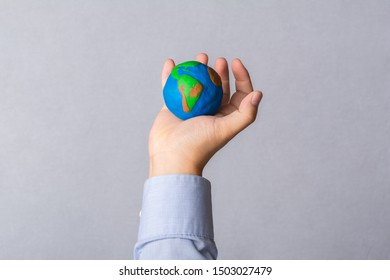 Earth globe in the hand.