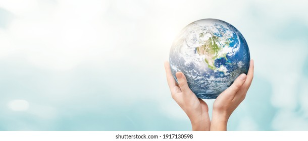 Earth globe in hands. World environment day concept. Elements of this image furnished by NASA