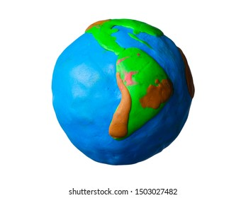Earth globe made of plasticine on a white background.