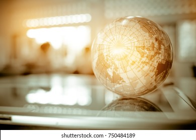 Earth globe model ball map with Radar background on tablet in classroom. Concept for global international education or communications, politics environmental for learning world wide. vintage tone