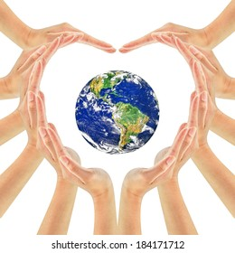 Earth globe on woman hands making heart shape isolated on white background . Unity, world peace, Earth care concept. Elements of this image furnished by NASA