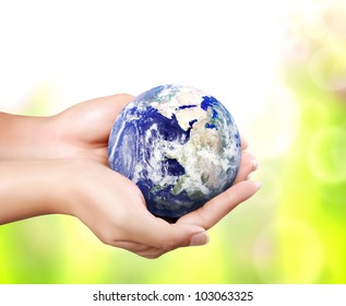 earth in hand (Elements of this image furnished by NASA)