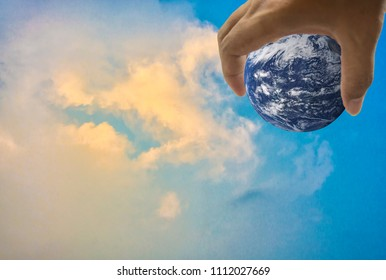 Earth, in a handful, With bright sky as the background, Abstract concept about global warming worldwide, Elements of this image furnished by NASA. (Photo manipulation)