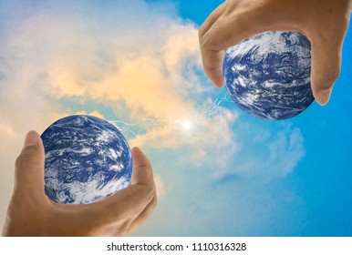 Earth, in a handful, lightning in middle, With bright sky as background, concept about global warming worldwide, Elements of this image furnished by NASA. (Photo manipulation)