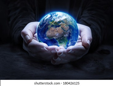 earth in hands - environment concept  - Europe, elements of this image furnished by NASA