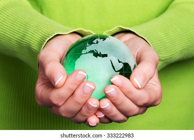 Earth in hands, environment concept, Europe, blue background