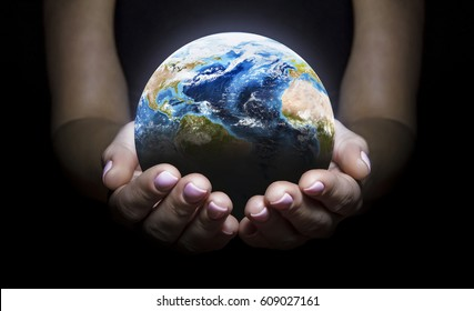 Earth in the hands isolated on black background. Elements of this image furnished by NASA. Space art. Astronomy and science concept. Earth day theme