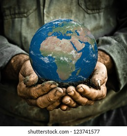 Earth in hands of old man. Ecology concept