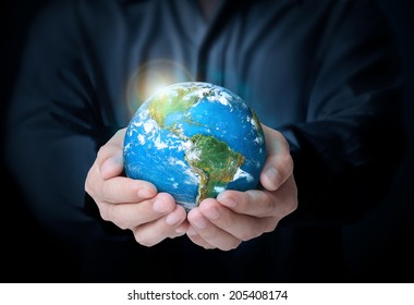 Earth in human the hand ,Some components of this image are provided courtesy of NASA