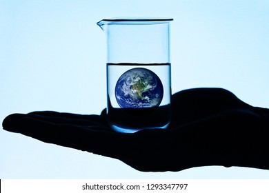 Earth in laboratory glass. Ecology concept. Elements of this image furnished by NASA.