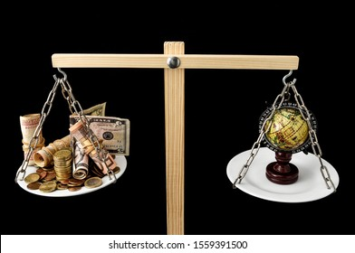 Earth and Money on a Two Pan Balance, money concept