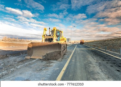 Earth moving by a bulldozer in the construction of a road in Spain.