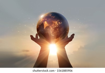Earth at night was holding in human hands. Earth day. Energy saving concept, Elements of this image furnished by NASA