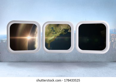 Earth on abstract screen against city scene in a room, elements of this image furnished by NASA