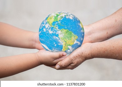 Earth on Baby Hand Idea of handing over the world on the hands of new generation children in the future.Elements of this image furnished by NASA.