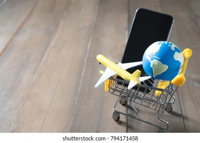 earth on shopping card above smart phone, eath image
