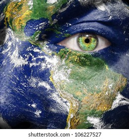 Earth painted on face to draw attention for a green and to create awareness for climate change - Elements of this image furnished by NASA