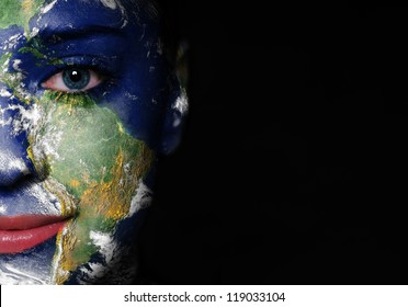 Earth painted on woman face. Elements of this image furnished by NASA