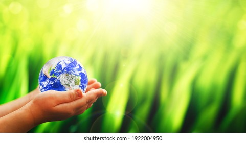 Earth planet in child hands.  Save and protection Earth. Concept of the Environment World Earth Day:  Elements of this image are furnished by NASA