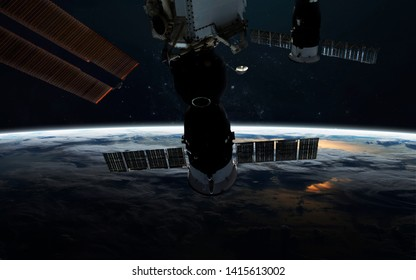 Earth planet close up and space station at orbit. Elements of this image furnished by NASA