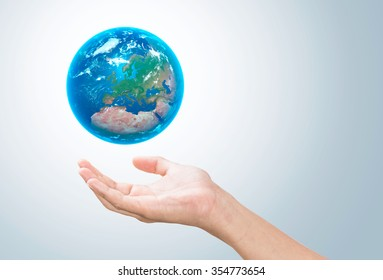 """Earth planet in female hand - Elements of this image furnished by NASA"""""""