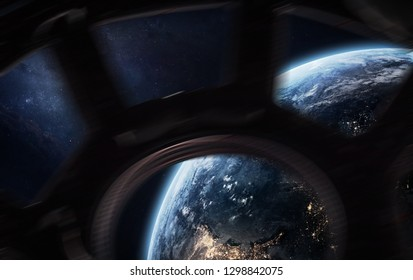 Earth planet in the ISS porthole. Exploration of the space. Elements of this image furnished by NASA