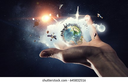 Earth planet in palm . Mixed media