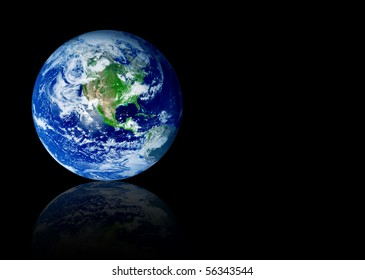 Earth planet with reflection over black background. Space to insert text or design