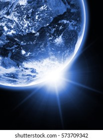 Earth planet in space with sun flash. Elements of this image are furnished by NASA