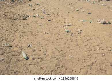 earth pollution result of human activity concept of many garbage objects on dirty sand background texture with empty space for copy or text