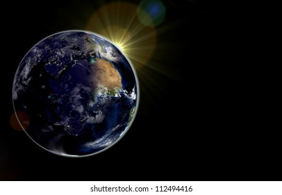 Earth with the rising sun. Day and night on the Earth. Elements of this image furnished by NASA