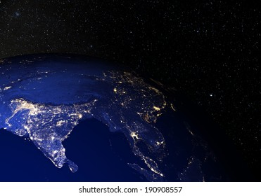 The Earth from space at night, with stars in the background. India. Elements of this image furnished by NASA. Other orientations available.