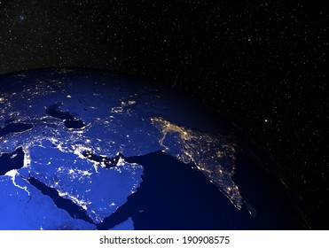 The Earth from space at night, with stars in the background. Middle East. Elements of this image furnished by NASA. Other orientations available.