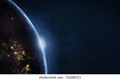 Earth with sun light. City lights on planet. Civilization. Elements of this image furnished by NASA