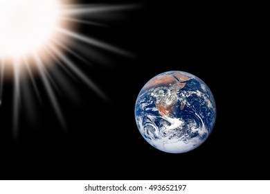 Earth and sun in space. Elements of this image furnished by NASA.