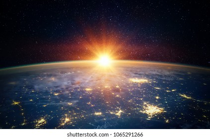 Earth, sun, star and galaxy. Sunrise over planet Earth, view from space. Elements of this image furnished by NASA - Shutterstock ID 1065291266