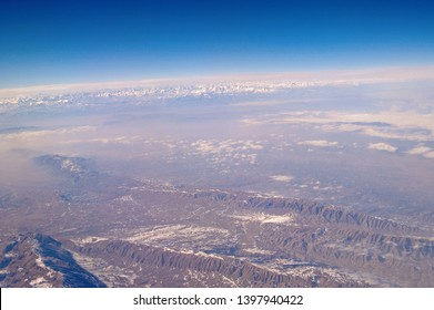 Earth surface on blue sky, aerial view. Environment protection and ecology. Mountain landscape. Wanderlust and travel. Heaven on earth.