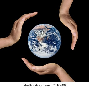 Earth surrounded by three hand. Isolated on black background.