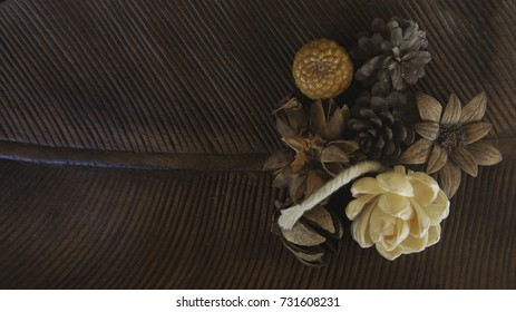 earth tone composition. Christmas gift, pine cones, stars, thuja branches and gypsophila flowers. Flat lay, top view, copy space.