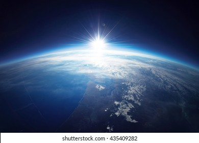 Earth view from space with sunrise. Photo is combination of real photo taken from weather balloon with some details furnished by NASA.