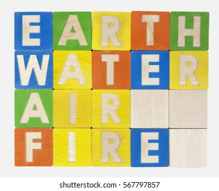 EARTH WATER AIR FIRE  elements spelled out in a grid of colorful toy blocks.