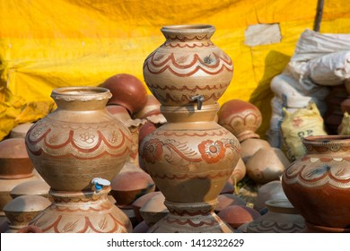Earthen pot being made using potter's wheel, India